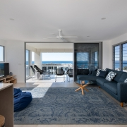 spacious open plan living room with sliding doors open to the terrace