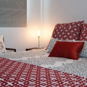 Red and white bedroom | Prestige Holiday Homes