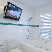 spacious bathroom with bath and tv balcony view from one of the houses| Prestige Holiday Homes