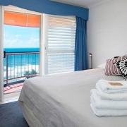 spacious bedroom overlooking the beach | Prestige Holiday Homes