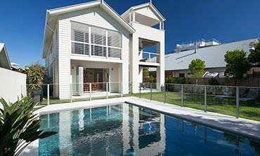 white modern house with pool area | Prestige Holiday Homes