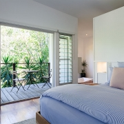 Bedroom that flows onto verandah at the Three Three Beach Bungalow holiday home.