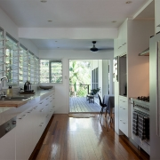 Kitchen that flows out onto outdoor deck at the Three Three Beach Bungalow holiday home.