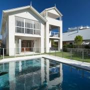 Big white modern house with pool