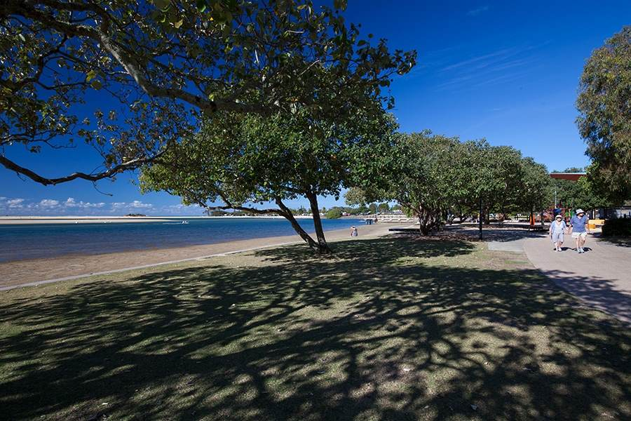 Photo of Mooloolaba beach and people walking on the footpath | Prestige Holiday Homes