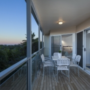 Balcony with an outdoor table and view to the ocean | | Prestige Holiday Homes