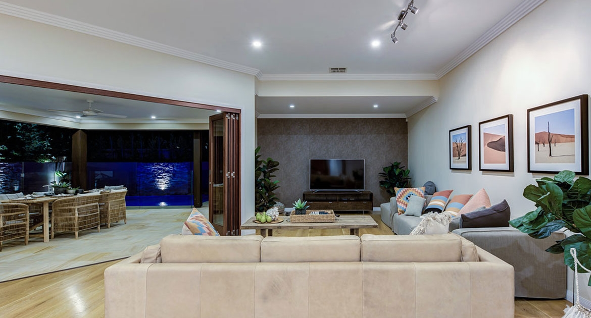 Lounge area with open bi-folds to outdoor entertaining area at Mudjimba Beach Retreat Holiday home.