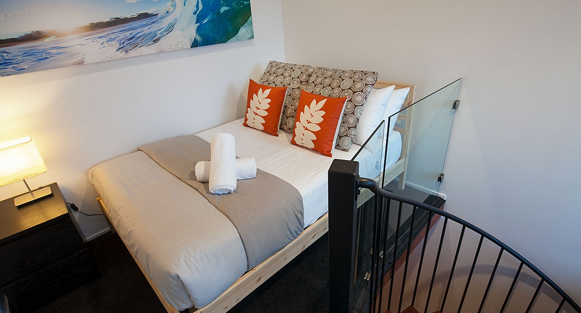 Bedroom at top of stairs at Peregian Beach Apartment Holiday Home.