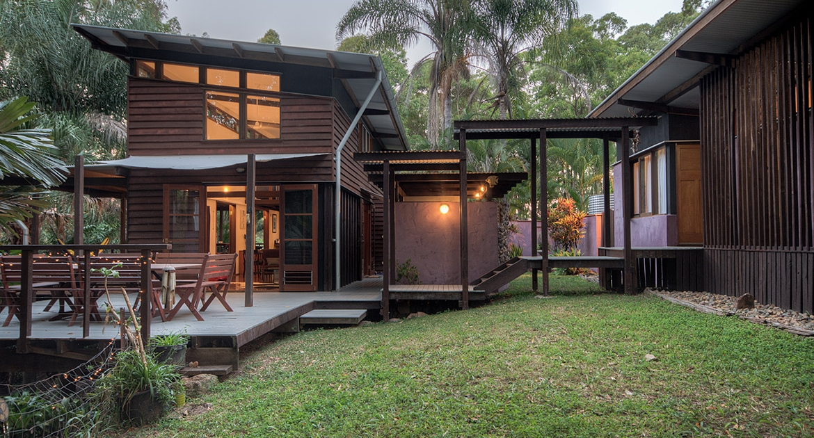 Outdoor view of connecting buildings at Lizard Funky Bush & Beach Retreat | Sunshine Coast Holiday Homes