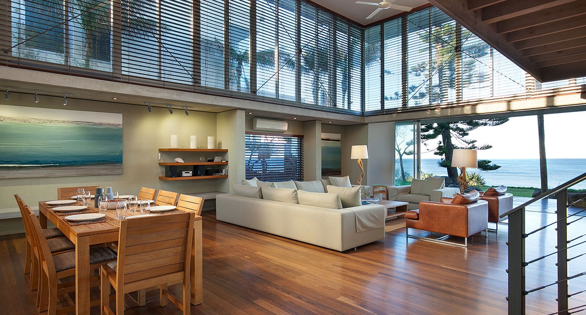 Stunning high vaulted ceiling living and dining room at Malibu Beachfront at Coolum Beach Holiday Home.
