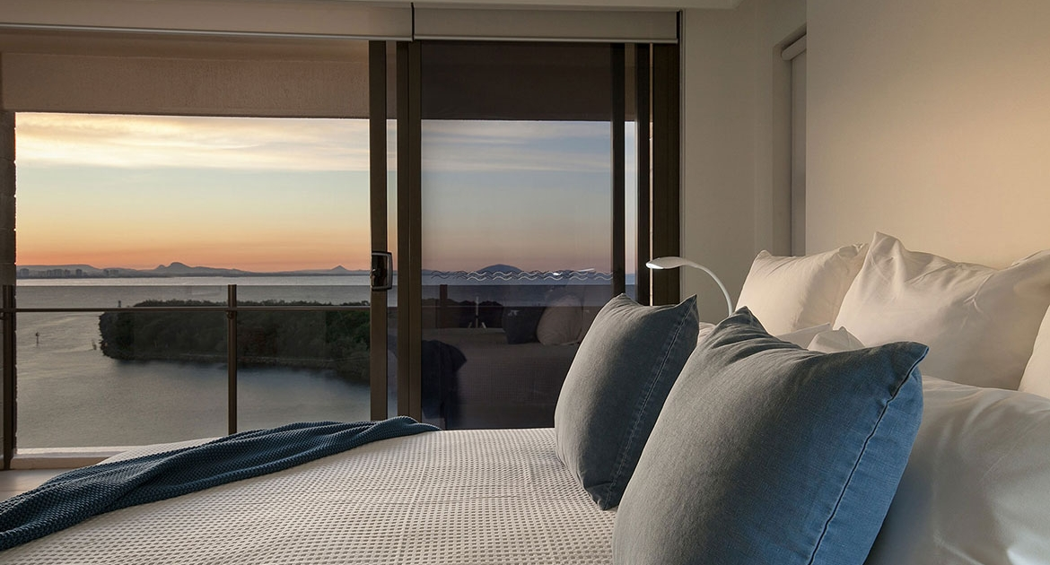 Bedroom with ocean views at Cartwright Beachfront Apartment | Sunshine Coast Holiday Rentals