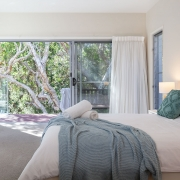 Bedroom with nature outside | Beach Wave House