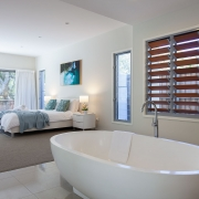 Master bedroom with giant bathtub | Beach Wave House