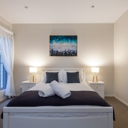 Front view of bed with ensuite | Beach Wave House