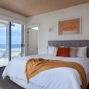 Master bedroom with well made bed | Saltwater Beach House