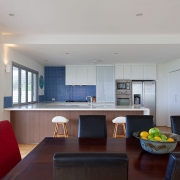 Good view of dining table and kitchen | Saltwater Beach House