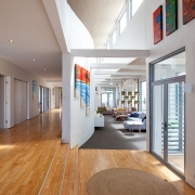 Expansive hallway with art | Saltwater Beach House