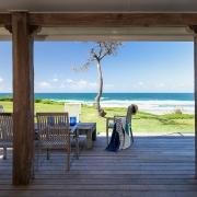 Wooden deck overlooking ocean | Saltwater Beach House
