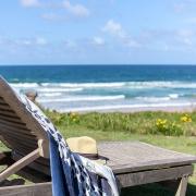 Deck chair overlooking ocean | Saltwater Beach House