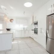 Kitchen and fridge at Bellavita Mudjimba Beach holiday home.