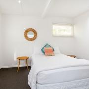 Guest bedroom at Bellavita Mudjimba Beach holiday home.