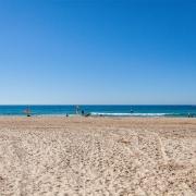 Mujimba beach with blue skies.