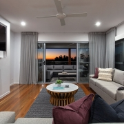 Living room at sunset at Sea Renity Coolum Beach | Sunshine Coast Holiday Homes