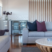 Living room and wine fridge at Sea Renity Coolum Beach | Sunshine Coast Holiday Homes