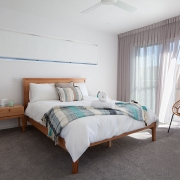 Queen bed with natural lighting at Sea Renity Coolum Beach | Sunshine Coast Holiday Homes
