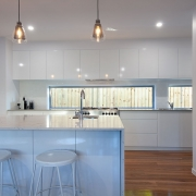 View of kitchen and a clock at Sea Renity Coolum Beach | Sunshine Coast Holiday Homes