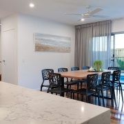 Kitchen and dining overlooking pool at Sea Renity Coolum Beach | Sunshine Coast Holiday Homes
