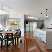 Polished wooden floors in kitchen and dining at Sea Renity Coolum Beach | Sunshine Coast Holiday Homes