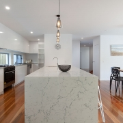 Wide angle shot of kitchen, dining at Sea Renity Coolum Beach | Sunshine Coast Holiday Homes