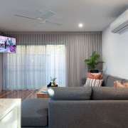 Living room with wall mounted TV at Sea Renity Coolum Beach | Sunshine Coast Holiday Homes