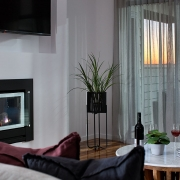 Fireplace with wine at Sea Renity Coolum Beach | Sunshine Coast Holiday Homes