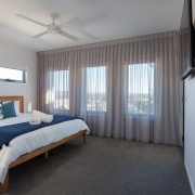 Bedroom with TV at Sea Renity Coolum Beach | Sunshine Coast Holiday Homes