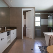 Large and spacious modern bathroom at Whitehaven Beach House Coolum holiday homes.