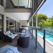 Outdoor pool and entertaining deck at Whitehaven Beach House Coolum holiday homes.