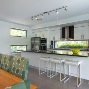 View of kitchen and dining area at Whitehaven Beach House Coolum holiday homes.