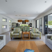 Long view of kitchen and living area at Whitehaven Beach House Coolum holiday homes.