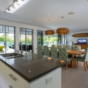 Full view of kitchen and living area at Whitehaven Beach House Coolum holiday homes.