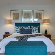 Front image of bed at Whitehaven Beach House Coolum holiday homes.