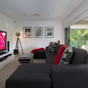 2nd floor lounge and entertainment area with a flat screen TV at Whitehaven Beach House Coolum holiday homes.