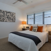 Bedroom with lamps on side tables at Whitehaven Beach House Coolum holiday homes.