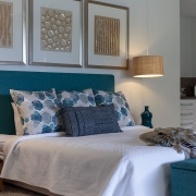 Master bedroom with walk in wardrobe at Whitehaven Beach House Coolum holiday homes.