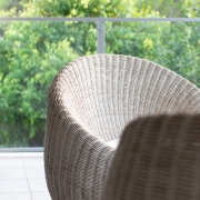 Cane chairs on balcony at Whitehaven Beach House Coolum holiday homes.