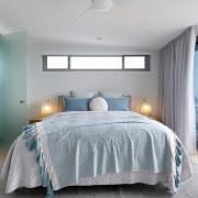 Master bedroom with ensuite and access to outdoor terrace at Thalassa Beachfront Penthouse Coolum holiday homes.