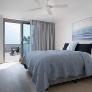 Bedroom with access to outdoor terrace at Thalassa Beachfront Penthouse Coolum holiday homes.