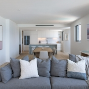Front view of kitchen and living area at Thalassa Beachfront Penthouse Coolum holiday homes.