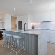Stone kitchen at Thalassa Beachfront Penthouse Coolum holiday homes.